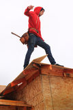 Carpenter on roof stock photography