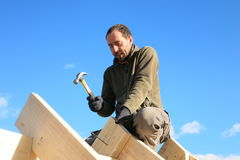 Carpenter on roof Royalty Free Stock Image