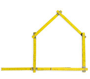 Carpenter Rule. Creating the silhouette of a house. With clipping path Stock Images