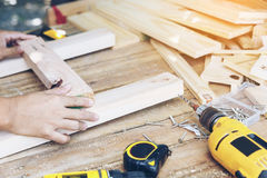 Carpenter. `s draft and test wood plate before stick it, DIY work at home concept Royalty Free Stock Photography