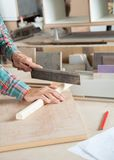 Carpenter's Hand Cutting Wood With Small Saw Stock Photography