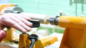 The carpenter`s hand processes the wooden part stock video