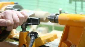 The carpenter`s hand processes the wooden part stock video footage