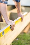 Carpenter's Hands Checking Level Of Wood Royalty Free Stock Photography