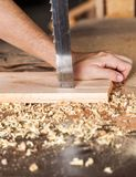Carpenter's Hands Cutting Plank With Bandsaw Stock Photos