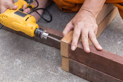 Carpenter`s hands man worker drilling wood royalty free stock photo