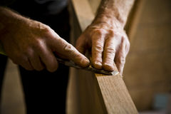 Carpenter's Hands at Work. Close-up of man doing carpentry. Horizontally framed shot Royalty Free Stock Images