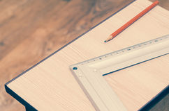 Carpenter`s pencil and set square.  Royalty Free Stock Image