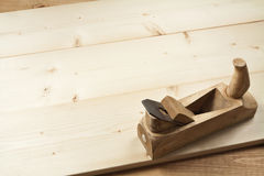 Carpenter's plane on a planks. Carpenter's plane on a wooden planks Royalty Free Stock Photography