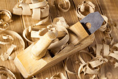 Carpenter's plane and shaving Royalty Free Stock Photography