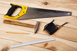 Carpenter's tools on pine desks Royalty Free Stock Photos