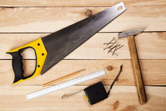 Carpenter's tools on pine desks Royalty Free Stock Photo