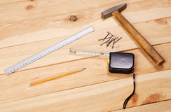 Carpenter's tools on pine desks Stock Photography
