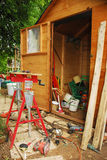 Carpenter's Work Bench and Messy Garden Shed Royalty Free Stock Photo