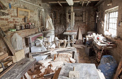 Carpenter's workshop. Old traditional carpenter's workshop with its wealth of tools and wood Royalty Free Stock Photos