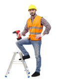 Carpenter with safety vest and drill Stock Photography