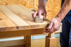 Carpenter sanding a table Royalty Free Stock Photo