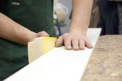 Carpenter sanding wood  Royalty Free Stock Photos
