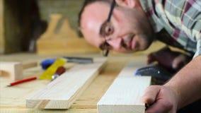 Carpenter sanding wood stock footage