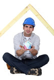 Carpenter sat cross-legged Stock Photography