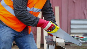 Carpenter with saw stock footage