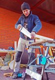 Carpenter with Saw Outdoor Royalty Free Stock Images