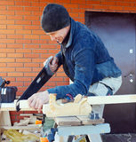 Carpenter with Saw Outdoor Stock Image
