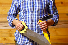 Carpenter with a saw and a ruler. Royalty Free Stock Images