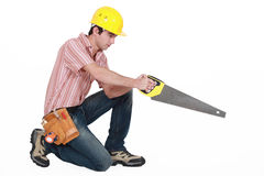 Carpenter with a saw Royalty Free Stock Photography