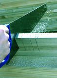 Carpenter sawing. Professional carpenter using a saw stock images