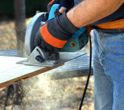 Carpenter Sawing Stock Image