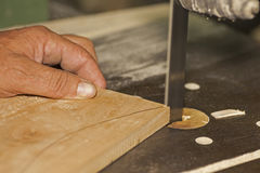 Carpenter sawing. On band saw Stock Photography