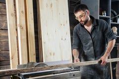 Carpenter sawing a circular saw Royalty Free Stock Photo