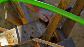 Carpenter Sawing the Wood stock footage