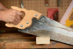 Carpenter Sawing Wood Stock Image