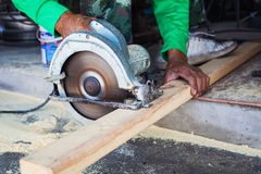Carpenter sawing wood. Two handles carpenter sawing wood Royalty Free Stock Photos