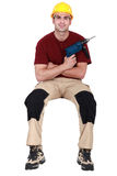 Carpenter with screwdriver Stock Photo