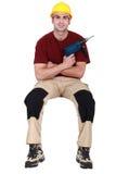 Carpenter with screwdriver Stock Photo