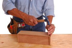 Carpenter setting nail Royalty Free Stock Image