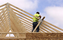 Carpenter setting Trusses for the roof of a house stock photos