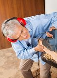 Carpenter Shaving Wood With Electric Planer Stock Images
