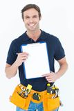 Carpenter showing blank clipboard Royalty Free Stock Image