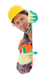 Carpenter showing blank sign. On the white background. Isolated on white stock photography