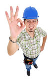 Carpenter showing OK sign. On the white background. Isolated on white royalty free stock image