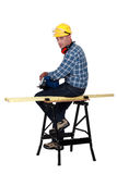 Carpenter sitting on bench Stock Photo