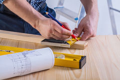 Carpenter sketching wooden plank very close up Royalty Free Stock Photo