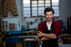 Carpenter smiling and crossing arms Royalty Free Stock Image