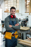 Carpenter smiling and crossing arms Stock Photo