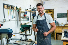 Carpenter smiling Stock Image