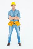 Carpenter standing arms crossed over white background Royalty Free Stock Photography